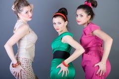 Three happy retro-styled girls Stock Photography
