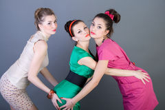 Three happy retro-styled girls Royalty Free Stock Photography