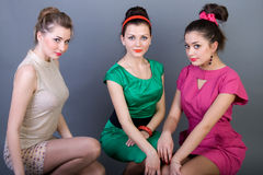 Three happy retro-styled girls Stock Photos