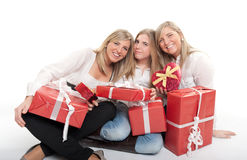 Three happy sisters with presents Stock Images