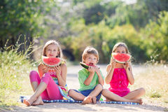 Three happy smiling child eating watermelon Stock Images