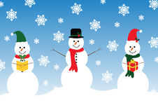 Three happy Snowman. One with a carol book with a bow tie and green Christmas hat, the second with a bowler hat with holly and red scarf and the third holding Stock Photo