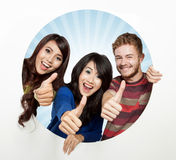 Three happy student come out from a white circle, thumbs up Royalty Free Stock Images