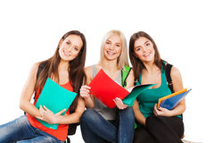 Three happy students sitting together with fun Royalty Free Stock Photography