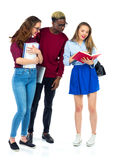 Three happy students standing and smiling with books Royalty Free Stock Photos