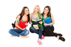 Three happy students standing together with fun. Happy university students sitting together with fun, while smiling and looking at camera isolated on white Stock Image