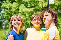 Three happy teenage boys smiling and looking up stock photography