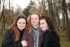 Three happy teenage girls. Having fun in the spring park Royalty Free Stock Photo