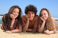 Three happy teenagers on the beach Stock Images