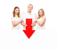 Three happy teenagers holding a red arrow on white Stock Photos