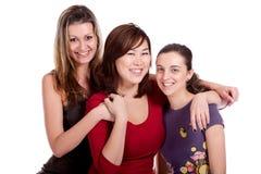 Three happy university students Stock Photo