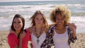 Three happy vivacious multiracial girl friends