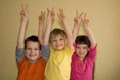 Three Happy Winners!. Three children all raise their hands in victory as they are all winners stock photos