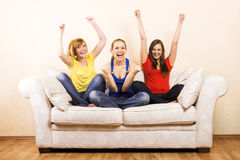 Three happy woman on a lounge Royalty Free Stock Photo