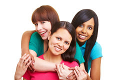Three happy women embracing each Stock Image