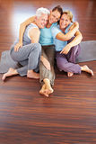 Three happy women in gym Stock Images