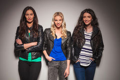 Three happy women in leather jackets smiling Stock Photography