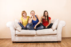 Three happy women on a lounge royalty free stock photography