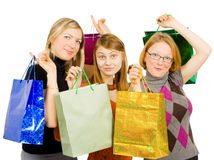 Three happy women after shopping. Isolated over white Royalty Free Stock Images