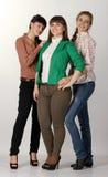 Three happy young beautiful girls girlfriends Royalty Free Stock Photo