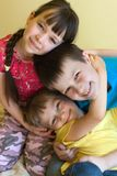 Three happy young children Stock Image