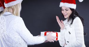 Three happy young girl in costume of Santa Claus with Christmas. Happy young girl in costume of Santa Claus with Christmas gifts. isolated on black.photo with Royalty Free Stock Images
