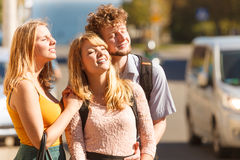 Three happy young people friends outdoor. Stock Photo