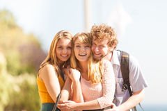 Three happy young people friends outdoor. Stock Images