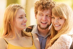 Three happy young people friends outdoor. Stock Image