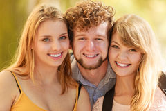 Three happy young people friends outdoor. Royalty Free Stock Photography