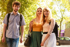 Three happy young people friends outdoor. Royalty Free Stock Photos