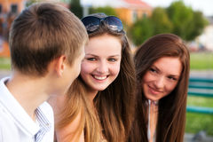 Three happy young teenagers Stock Image