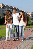 Three happy young teenagers Stock Photo