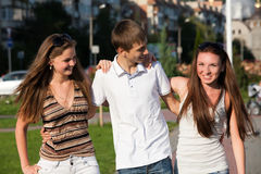 Three happy young teenagers Stock Images