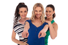 Three happy young women pointing fingers Stock Photo