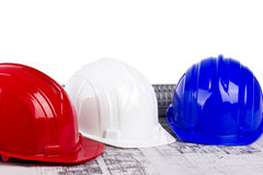 Three hard hats on blueprint Royalty Free Stock Photography