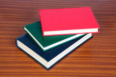 Three hardcover books Stock Photography