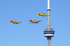 Three Harvard Aircraft fly by CN Tower Toronto Royalty Free Stock Image