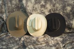 Three hats 2. Three cowboy hats. black hat, brown hat and straw hat Royalty Free Stock Photography