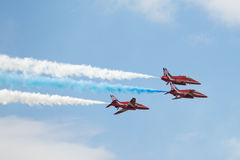 Three Hawk T1 jets on air show. Air show, three Hawk T1 jets with colored smoke on air show Royalty Free Stock Image