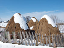 Three haystacks with snow tops Stock Images