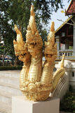 A three-headed dragon statue in the temple. King of Nagas three head Stock Images