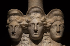 Three headed roman-asian ancient statue of beautiful women Royalty Free Stock Image