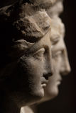 Three headed roman-asian ancient statue of beautiful women Stock Photography