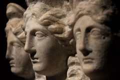 Three headed roman-asian ancient statue of beautiful women Stock Photos