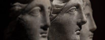 Three headed roman-asian ancient statue of beautiful women at bl Stock Photo