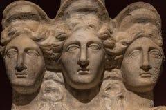 Three headed roman-asian ancient statue of beautiful women, Godd Royalty Free Stock Image