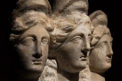 Three headed roman-asian ancient statue of beautiful women, Godd Stock Photos