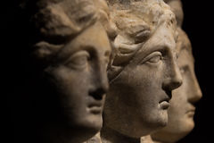 Three headed roman-asian ancient statue of beautiful women, Godd Stock Photography