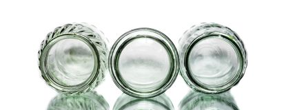 Three heads of jars. Herads of three jars on white background and reflective surface stock images